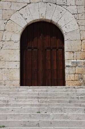 Stairs and wooden door of an old building Stock Photo - 3409636