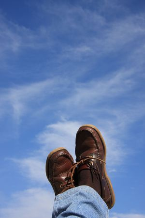 Man relaxing with his feet on the air photo