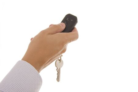 Man hand holding a garage door remote control