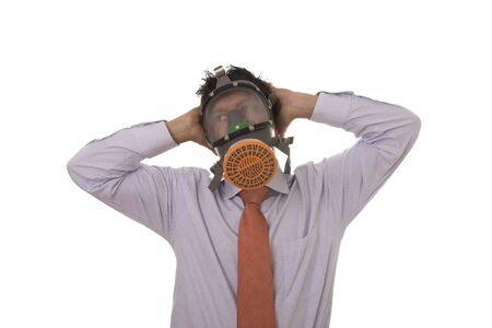 A business man with a gas mask on his face Stock Photo - 3714121