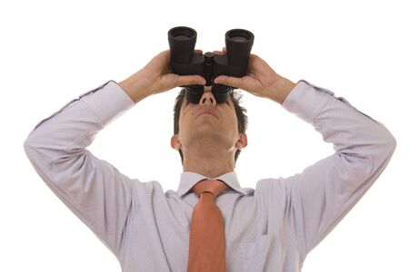 Business man looking up with binoculars photo