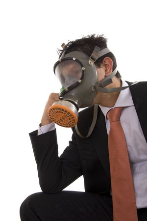 A business man with a gas mask thinking photo
