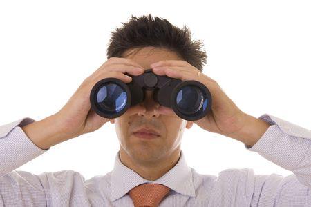 A business man looking through binocular