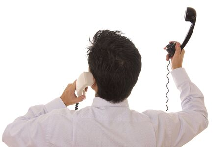 Busy business man with many telephone at the same time photo