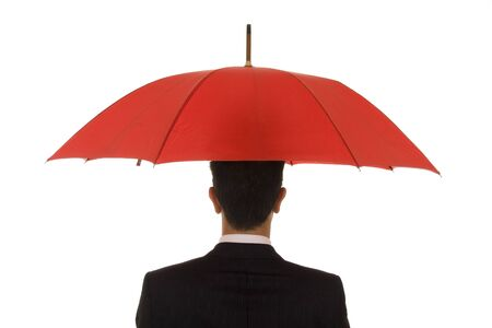 An insurance agent ready to protect you with his umbrella Stock Photo - 3790242