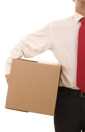 Business man holding a carboard box isolated on white