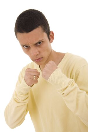 A portrait of a young man ready to fight photo