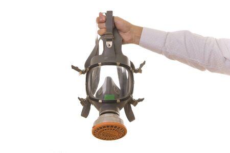 radium: Hand holding a gas mask isolated on white
