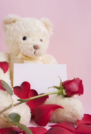 pink teddy bear: Valentine concept - A beautiful bear with roses and a card with space for text