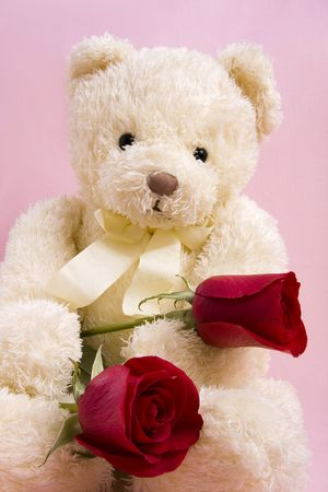 Vlentine Concept - Bear with two red roses Stock Photo