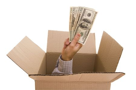 Hand with dollars inside a cardboard box Stock Photo