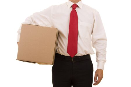Business man holding a cardboard box isolated on white photo