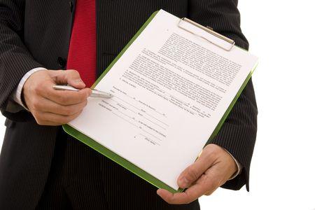 legal document: Hombre de negocios que muestra el lugar en el que el vendedor debe firmar el contrato (contrato de la casa) Foto de archivo