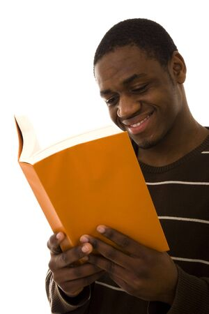 A smiling man reading a book isolated on white