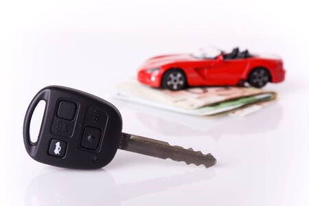 New car Concept - Key and a red car with euro banknotes (selective focus on the key) photo