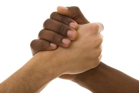 black handshake: Black and white hands shaking in friendly agreement isolated on white