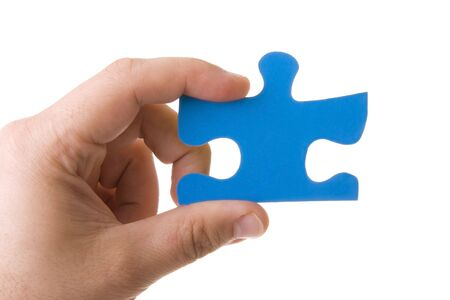 Hand holding a blue puzzle isolated on white Stock Photo - 4664424