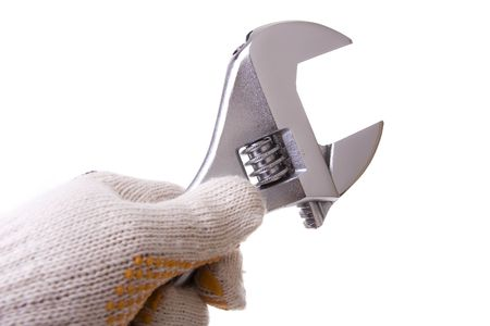 Hand with a glove holding a wrench key isolated on white photo