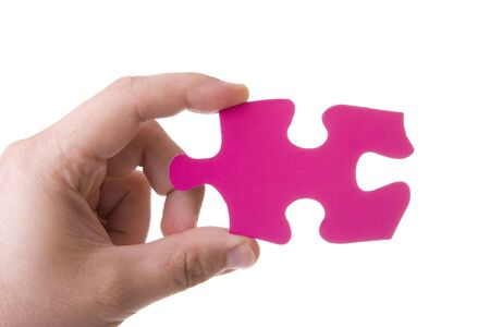 Hand holding a pink puzzle isolated on white Stock Photo - 4664429
