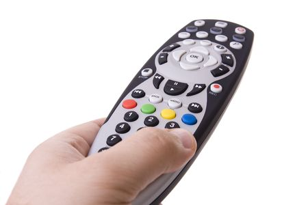 Hand holding a tv remote control (Focus on the RGYB buttons)