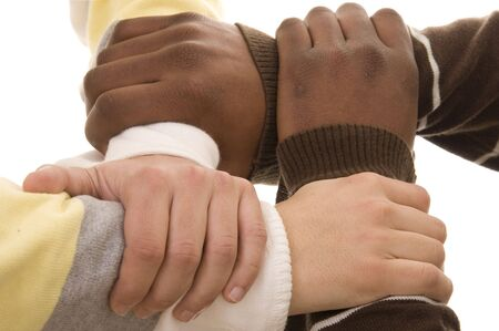 Multiracial hands holding each other isolated on white photo