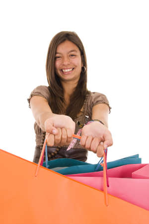 Happy young girl holding coloful shopping bags Stock Photo - 4879533