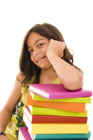 Happy young girl with colorful books photo