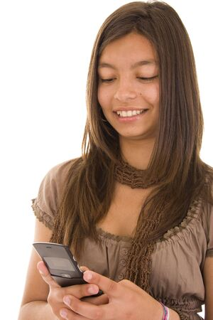 Young girl readind a SMS on his phone  photo