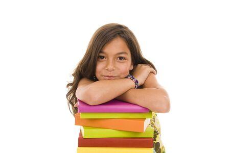 ni�os pensando: Feliz ni�a con coloridos libros Foto de archivo