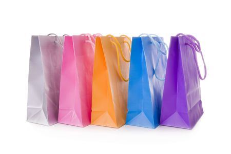 Five colorful shopping bags isolated on white photo