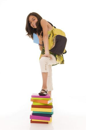 Happy young girl with a stack of colorful books isolated on white Stock Photo
