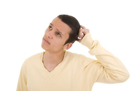 Young man with a pensive expression looking up photo