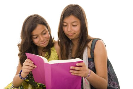 Two young girls reading a school book photo