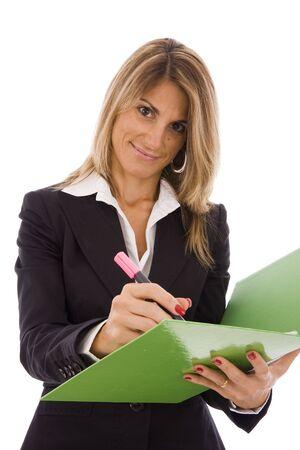 Beautiful business women high-lighting a document photo
