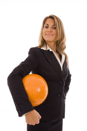 Business woman holding a orange ball isolated on a white background photo