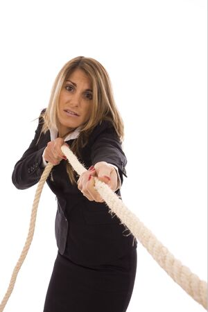 Business woman pulling a rope isolate on white background photo
