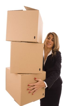 Blond businesswoman carrying three cardboard boxes photo