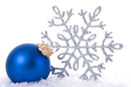 Christmas Decoration: blue bauble and silver snow symbol