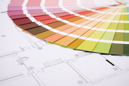Color samples for selection with house plan on background photo