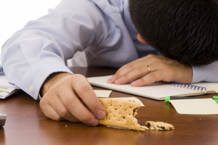 An exhausted worker sleeping at office - Focus on the cracker