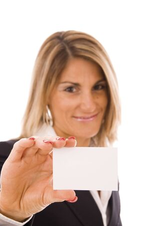 Beautiful women holding her business card (focus on the hand) Stock Photo - 6166265
