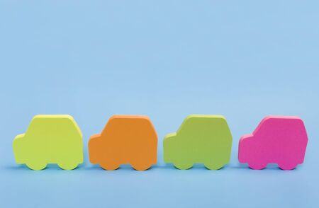 four funny colorful cars isolated on a blue background Stock Photo - 6402243