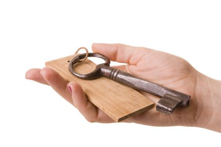 Female hand holding an old rusty key Stock Photo - 6402238