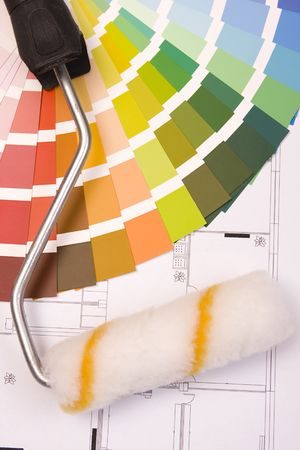 Color samples for selection and a a painter�s roll with house plan on background