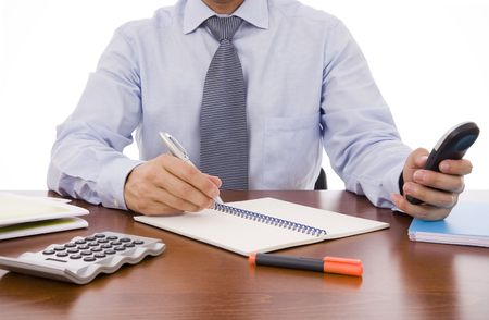 Busy business man writing something in his notebook photo