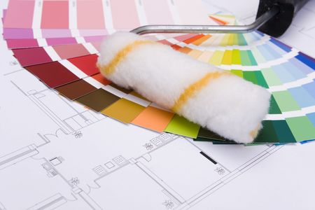 Color samples for selection and a a painter´s roll with house plan on background Stock Photo - 6908629