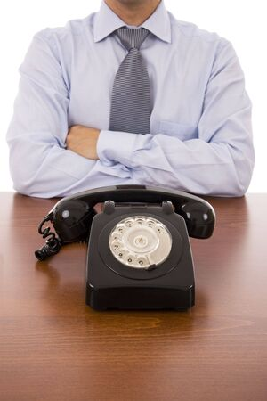 businessman waiting call: Business man with crossed arms waiting for a call Stock Photo