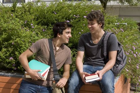 Two college or university students speaking and smiling photo