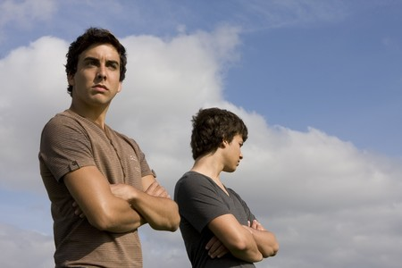 Two young men looking on opposite sides Stock Photo - 7066769