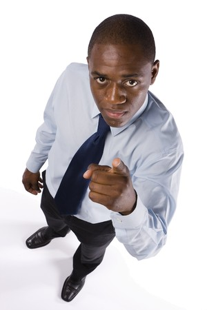 Sucessful business man pointing to someone with a serious expression